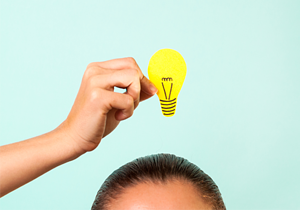 Image: woman with lightbulb over head